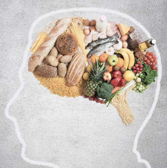 Outline of person head with healthy food filling the brain